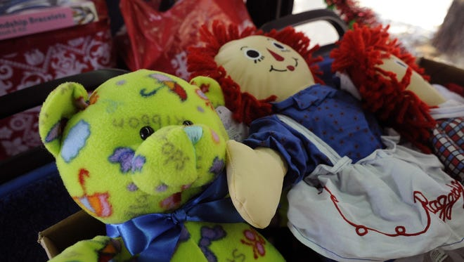 A file photo of toys. The owner of Sippee's children store is collecting donations to help the grieving family of a woman and her unborn child, who died in a rollover crash last week.