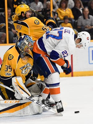 Predators goalie Pekka Rinne (35) and defenseman Roman Josi (59) defend the goal against Islanders left wing Anders Lee (27) during the second period at Bridgestone Arena Tuesday, April 4, 2017 in Nashville, Tenn.