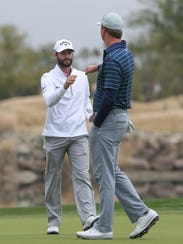 Hudson Swafford and Adam Hadwin bump fists after each