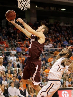 Texas A&M Aggies forward Alex Caruso (21) takes a shot past Auburn Tigers guard KT Harrell (1) during the first half at Auburn Arena. Mandatory Credit: John Reed-USA TODAY Sports