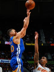 Stephen Curry of the Golden State Warriors shoots a
