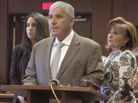 Wayne Friedland, the father of murder victim Dustin Friedland, addresses the court as he reads his victim impact statement in Superior Court in Newark, N.J., Thursday, Jan. 17, 2018. His daughter, Deanna, left, and wife Rose, right are at his side.