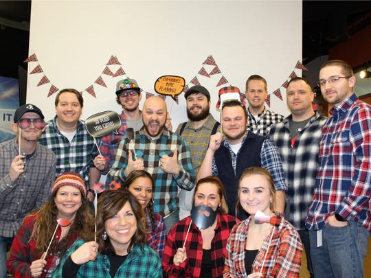 Kingsgate workers celebrating Flannel Friday in February 2018.