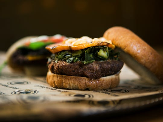 October 26, 2016 - The black-eyed pea burger at Belly Acres includes pickled collard greens, roasted sweet potato, and siracha aioli on a wheat bun.