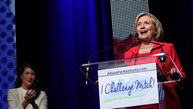 Former U.S. Secretary of State Hillary Clinton, right, campaigns for Alison Lundergan Grimes, left, at the Kentucky International Convention Center in Louisville. Grimes is running against incumbent Sen. Mitch McConnell (R-Kentucky). Oct. 15, 2014.
