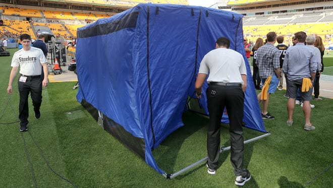 The medical tent for the Pittsburgh Steelers is set up on the field before an NFL football game against the Cincinnati Bengals in Pittsburgh, Sunday, Oct. 22, 2017. (