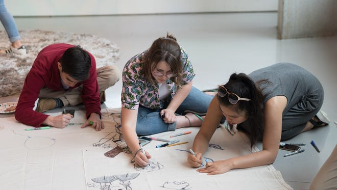 Teens participate in a mural-making project at one of the weekly Young Adult Labs offered by the Contemporary Arts Center. The free sessions are aimed at young people ages 12 to 20 and are social gatherings as much as they are arts workshops.
