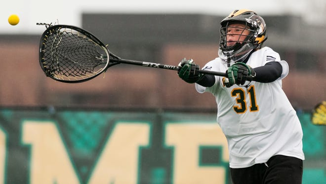 Vermont goalie Meg Hopkins (31) throws the ball down the field during the women's lacrosse game between the Stony Brook Sea Wolves and the Vermont Catamounts at Virtue Field on Saturday in Burlington, Vermont.