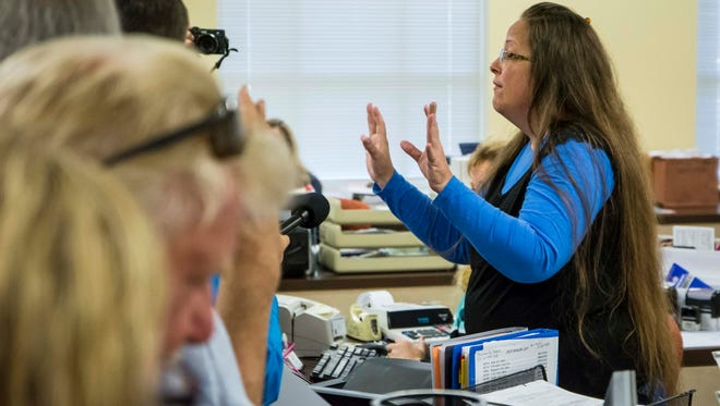 Rowan County Clerk Kim Davis, right, argues with David Moore and David Ernold, after they were denied a marriage license at the Rowan County Courthouse in Morehead.(September 1, 2015)