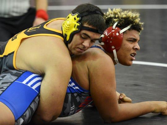 Caden Norris of Merritt Island wrestles Omar Lagarde