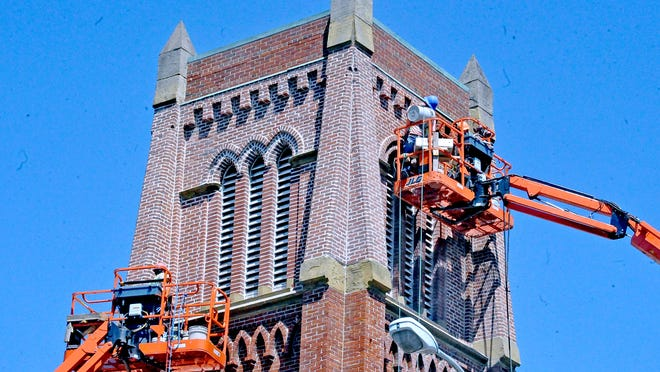There is nothing but blue skies as workers restore the brick spire on the Trinity United Church of Christ building in downtown Wooster this week.