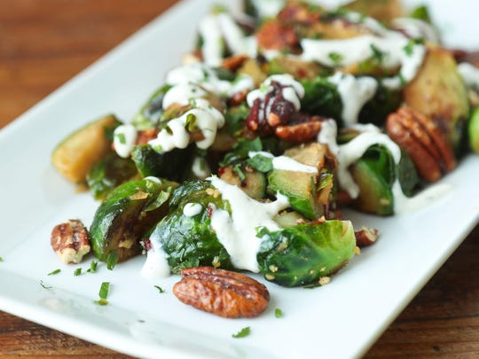 Brussels sprouts with pecans and herb goat cheese from