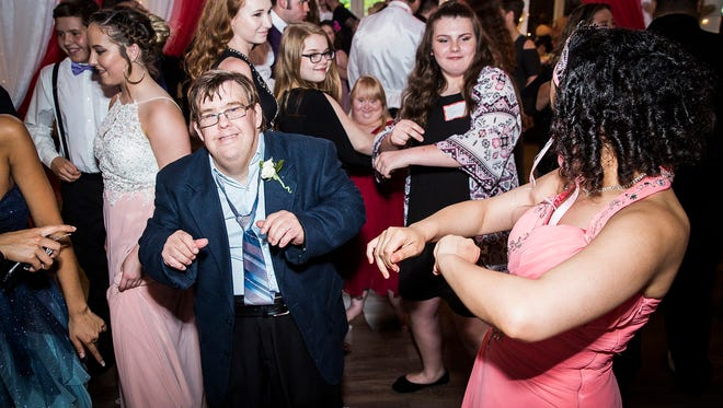 """Volunteers, caregivers and community members with special needs celebrated their 2018 prom at The Loft in Yorktown Saturday night. This year's prom was themed """"Under the Big Top"""" and featured circus decor and costumes."""