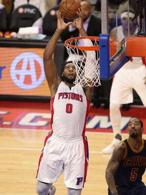 Pistons center Andre Drummond scores against Cavaliers guard J.R. Smith during the second period of Game 4 of the Eastern Conference quarterfinals Sunday at the Palace.