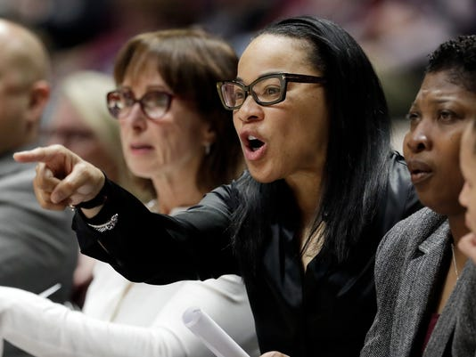 South Carolina head coach Dawn Staley, center, yells to her players in the second half of an NCAA college basketball semifinal game against Georgia at the women's Southeastern Conference tournament, Saturday, March 3, 2018, in Nashville, Tenn. South Carolina won 71-49 to advance to Sunday's championship game against Mississippi State. (AP Photo/Mark Humphrey)
