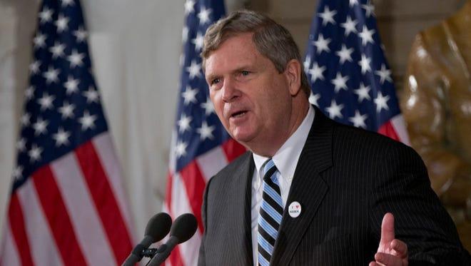 Agriculture Secretary Tom Vilsack gestures as he speaks on Capitol Hill in 2014.