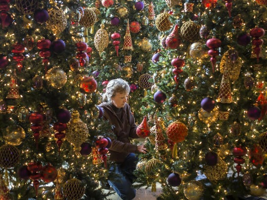 Kathy Gore decorated trees for the Nutcracker in the
