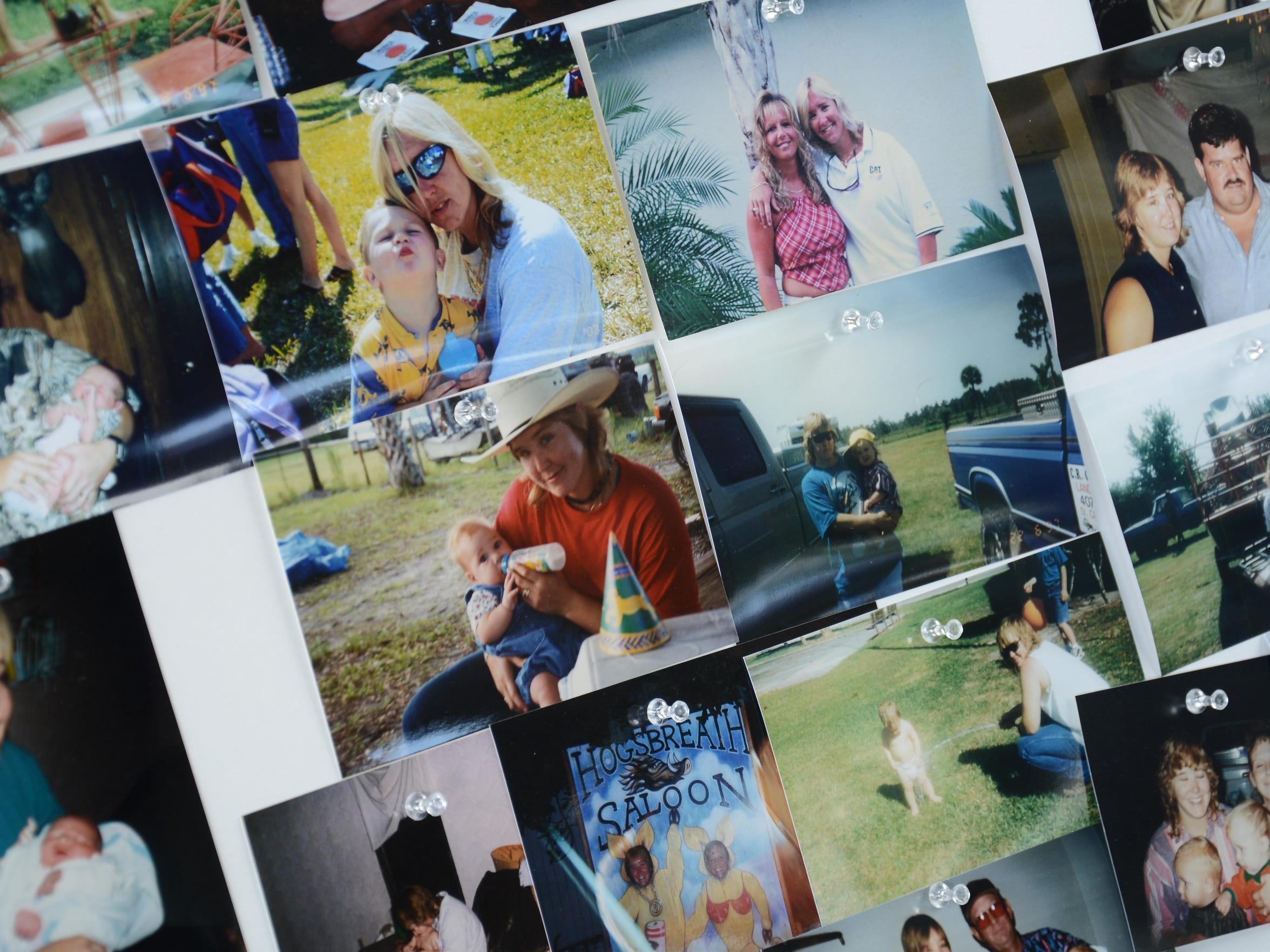 Pictures of Brandy Hall fill a poster in Malabar Community Park Saturday, where friends and family gathered for a celebration of her life. Hall disappeared after leaving work 10 years ago.