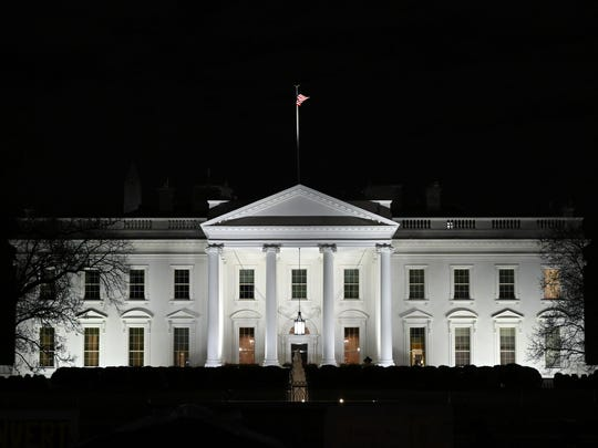In this Jan. 23, 2019, photo, a view of the White House in Washington. As President Donald Trump's approval rating falls, the Republican Party is grasping him ever tighter.