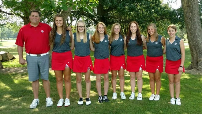 Shelby golf coach Brad Ruminski has twice seen his team break the school record for nine holes this season. The girls, left to right: Claire Korbas, Megan Owen, Gillian Stumbo, Amanda Ruminski, Emma Roberts, Lexi Uplinger and Julia Gutchall.
