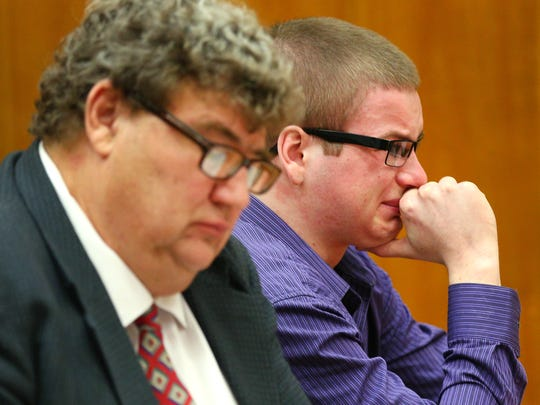 Brett Pearson listens to a family member speak before he is sentenced to at least 40 years in prison after pleading guilty in the murder of his mother and attempted murder of his father, Wednesday, Sept. 23, 2015, at the Marion County Courthouse in Salem.