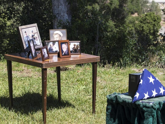 Photos and a U.S. flag were on display in honor of