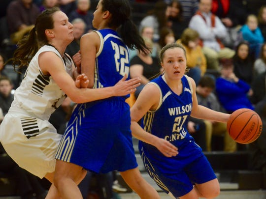 Wilson Central's Kendall Spray (21) cuts around teammate