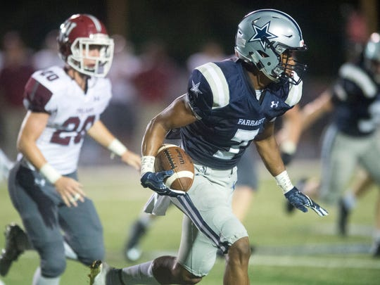 Farragut's Jaden Gibbs looks for an opening in the Morristown West defense. Farragut defeated Morristown West, 33-10 on Thursday, August 31, 2017.