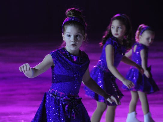 Members of the Learn to Skate class perform during