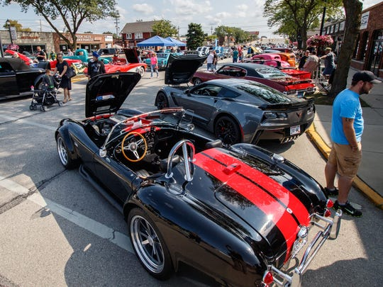 Car enthusiasts take in the sights and sounds during the 2017 Hot Rods On Hampton extravaganza in the village of Butler. The annual event features hundreds of cars spread across 8 city blocks along with food, refreshments and vendor booths.