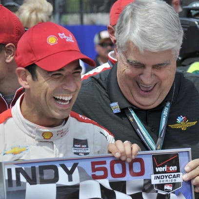 Helio Castroneves accepts the pit stop competition