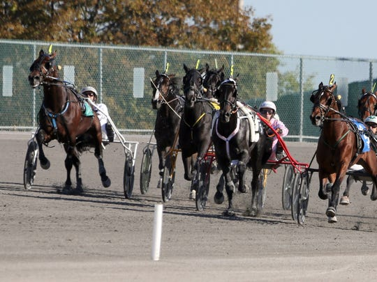Resolve, at right, driven by Ake Svanstedt. , won the 2016 $1,000,000 International Trot at Yonkers Raceway Oct. 15, 2016.