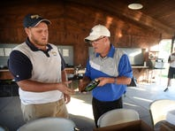 Cedar Crest coach Rick Dissinger presents the first place trophy to Elco's Cody Tobias during the Lebanon County Golf Tournament on Monday.