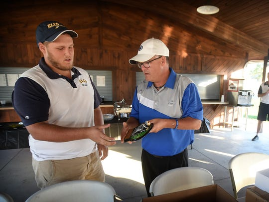 Cedar Crest coach Rick Dissinger presents the first