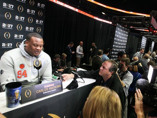 Clemson defensive tackle Carlos Watkins answers a question during media day on Saturday in Tampa, Florida.