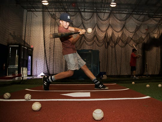 Tyler Kelly, 13, takes batting practice on Wednesday