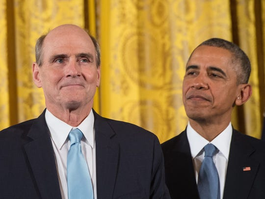 U.S. President Barack Obama and singer/songwriter James Taylor attend a Presidential Medal of Freedom ceremony at the White House in Washington, D.C., on Nov. 24, 2015.