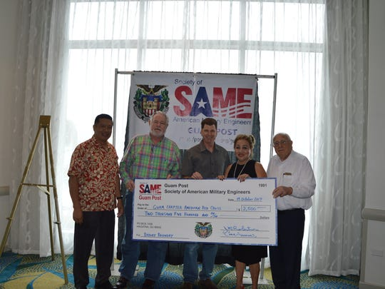 The Guam Post of the Society of American Military Engineers recently held a hurricane relief effort to provide financial support to the victims of Hurricane Harvey in Houston, Texas and surrounding communities. SAME Guam Post, together with generous donations from its members, presented a check in the amount of $2,500 to the American Red Cross, Guam Chapter. Pictured from left: Noel Enriquez, Wayne Cornell, Chris Arnsfield, Chita Blaise (American Red Cross, Guam Chapter) and John Robertson.