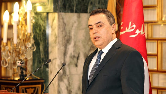 Interim Prime Minister Mehdi Jomaa addresses the media after the new government presentation ceremony at the presidential palace in Carthage near Tunis, Sunday