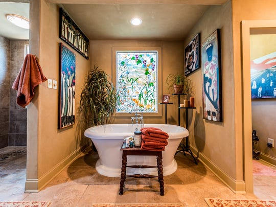 There are two beautiful master bathroom suites.