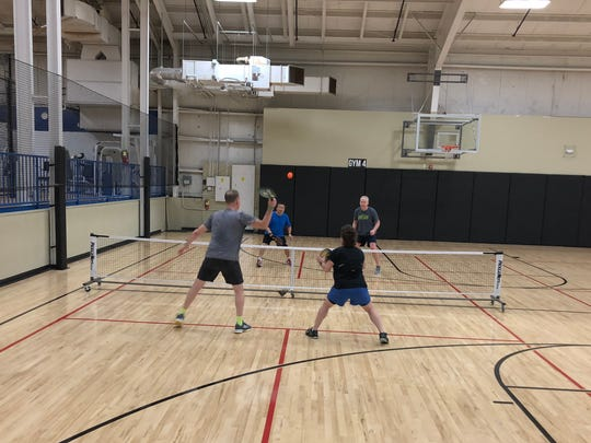 More than 100 members of the Prairie Athletic club (near Madison) play pickleball.