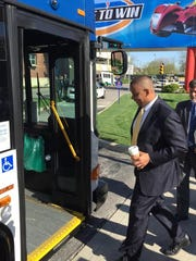 U.S. Transportation Seretary. Anthony Foxx is shown on April 23, 2015, as he boards an IndyGo all-electric bus to take a tour of the proposed Red Line bus rapid transit route.