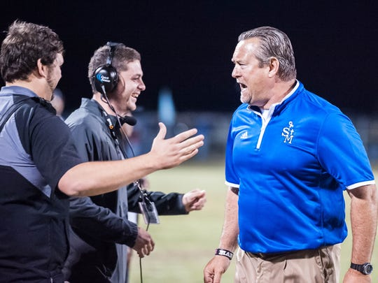 Advertiser photo by Buddy Delahoussaye-- St . Mary head coach Lee Doty celebrating the victory  in an LHSAA semi-final matchup in the select division IV on Friday Nov. 27, 2015.