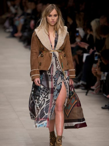 This Feb. 17, 2014 file photo shows model Suki Waterhouse wearing a design created by Burberry Prorsum Womenswear during London Fashion Week Autumn/Winter 2014. Lucky magazine style editor Laurel Pantin says trends for cooler weather include baby blue outerwear, shearling coats, oversized sweaters, plaids, black-and-white prints, straight trouser pants, hiking boots, blanket coats and Pendleton prints.