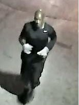 A photo taken from video surveillance of the suspect in a series overnight Thursday on the city's northwest side.