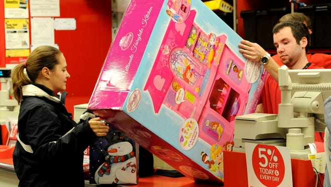 Tandra Ahrens of Fort Ripley, Minn., returns an Ultimate Fairytale Kitchen to Michael McDonald in customer service at the Target Store in Baxter, Minn., on Dec. 26, 2012.