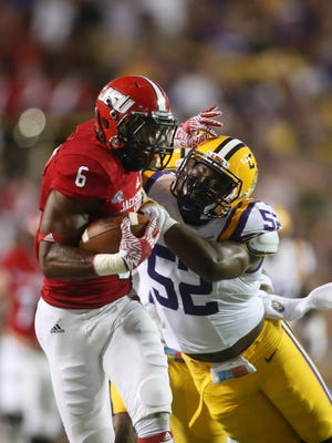 Sep 10, 2016; Baton Rouge, LA, USA; Jacksonville State Gamecocks running back Roc Thomas (6) fights off LSU Tigers linebacker Kendell Beckwith (52) as he carries the ball in the first quarter at Tiger Stadium. Mandatory Credit: Crystal LoGiudice-USA TODAY Sports