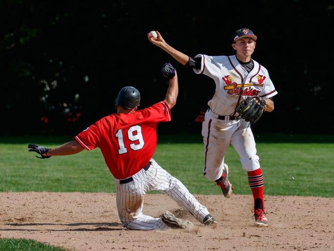 Sussex shortstop Trevor Wesline (12) gets Pewaukee's