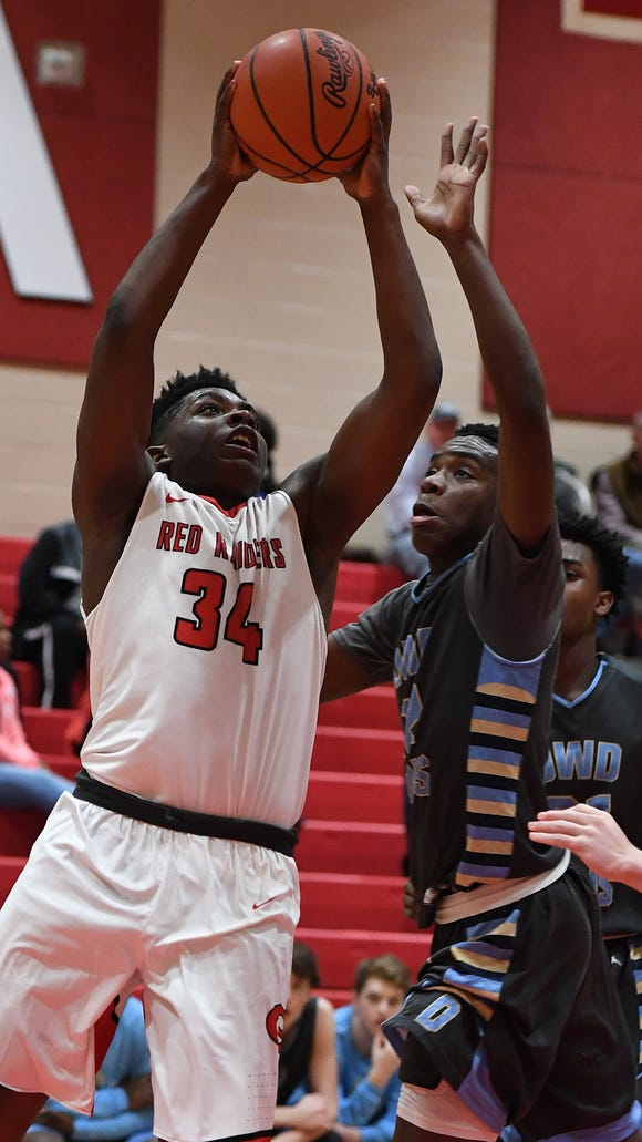 Greenville's J.Q. Jones (34) drives to the basket against Daniel during the Red Raiders' 56-41 win Tuesday night at Slick Moore Gymnasium.