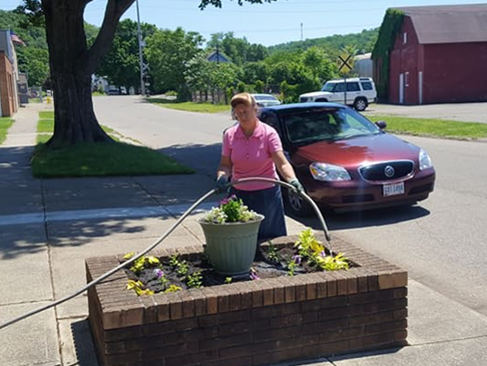 Theresa Hartle has taken care of flower beds at Calvary
